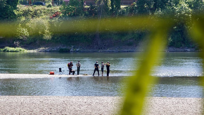 Search and rescue crews from more than six agencies search in the Willamette River in Salem for a 5-year-old boy that disappeared while playing at Wallace Marine Park on Saturday, August 5, 2017.