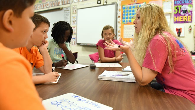 Jeananne Soukup works with 4th grade students Justus Knorr, Sam Weidner, Kylie Morris and Kelly Monich as part of a data driven instruction model at Annie Sullivan Elementary in Sioux Falls, S.D., Wednesday, May 25, 2016.