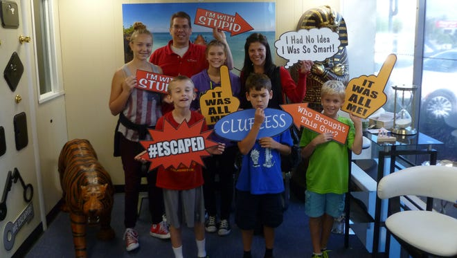Recent Escape Room Zone participants (back, from left) Lia Schroeder, Joe Fleming, Kristen Fleming and Pam Zinkosky and (front, from left) Harrison Christina, Ben Fleming and Benjamin Peura.