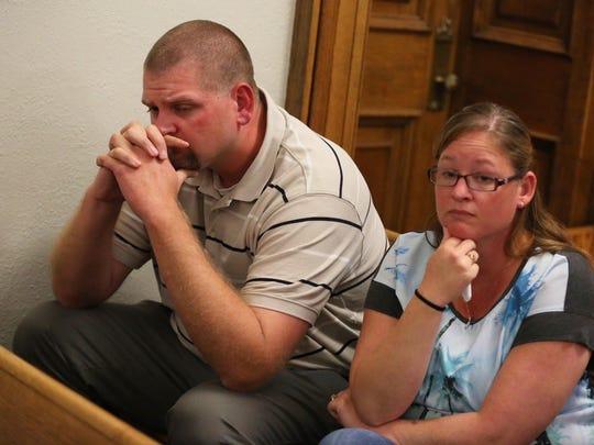 Victim Mark Mitchell (left) watches Pete Polson's reaction