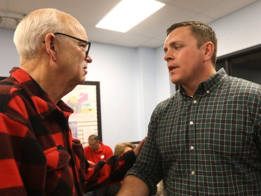 Patrick Testin shares positive thoughts on the outcome of the election with a Republican voter at a watch party in Stevens Point on Election Night.