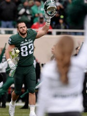 Senior tight end Josiah Price is honored for Senior Day before the game against Ohio State on Saturday, Nov. 19, 2016, at Spartan Stadium in East Lansing.