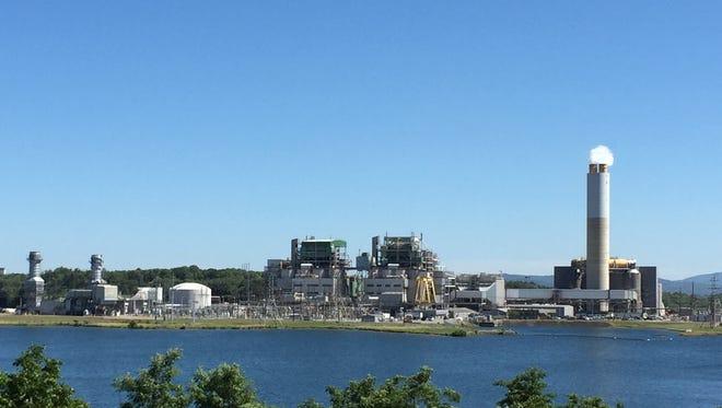 Duke Energy's plant on Lake Julian primarily burns coal but also uses natural gas.
