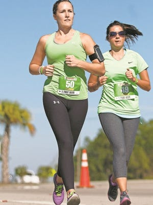 At right, Sydnie Howk was among more than 200 people participating in the Stoplight Run and Party.
