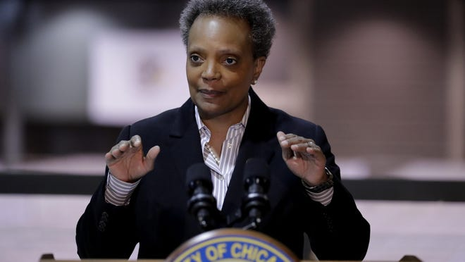 FILE - In this April 10, 2020, file photo Chicago Mayor Lori Lightfoot speaks during a news conference at McCormick Place in Chicago.