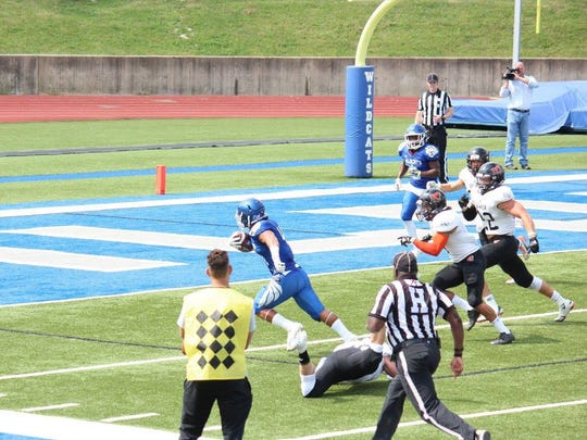 Juan King Jr. breaks free and heads for the end zone. He made several first downs and scored a touchdown for the Culver-Stockton Wildcats.