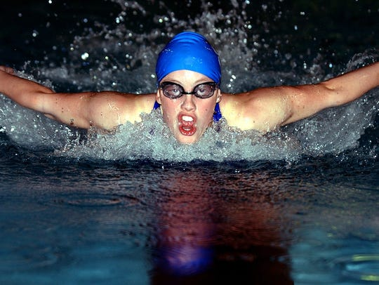 Centerville Abby Kettler swims the 100-meter butterfly