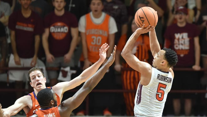 Virginia Tech Hokies guard Justin Robinson (5) shoots over Clemson Tigers forward Aamir Simms (25) in the first half at Cassell Coliseum. Mandatory Credit: Michael Shroyer-USA TODAY Sports