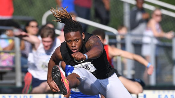 GreerÕs Qua White runs in the 100 meter hurdles during day two of the Greenville County Track and Field Championships at Eastside High on Tuesday, April 17, 2018,