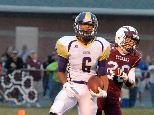 Waynesboro's Jaduintus Chambers celebrates a pass completion against the Stuarts Draft defense during the first half of a football game played in Stuarts Draft on Friday, Sept. 12, 2014.