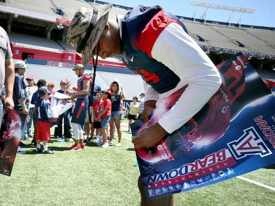 Arizona quarterback Khalil Tate signs autographs for fans at the UA's Fan Appreciation Day.