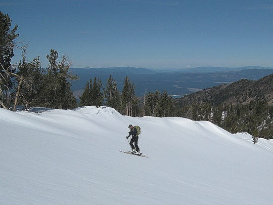 Mt. Lassen is visible as a white spot on the distant horizon from Rose Knob Jr., Peak in the Tahoe Basin, shown on March 28, 2015.