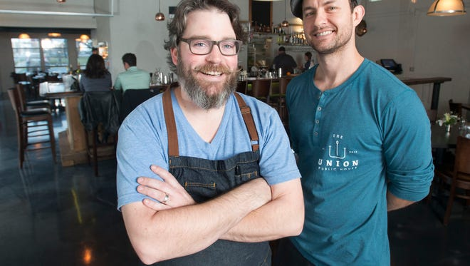 Blake Rushing, left, and Patrick Bolster, right, have opened the Union Public House restaurant on South Reus Street in downtown Pensacola.