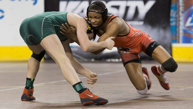 Bound Brook's Mekhi Lewis works in for a takedown during his 145 lbs bout against Stanley  Atkinson of Clearview. Quarterfinal Round at  NJSIAA State Wrestling Tournament in Atlantic City, NJ on March 5, 2016