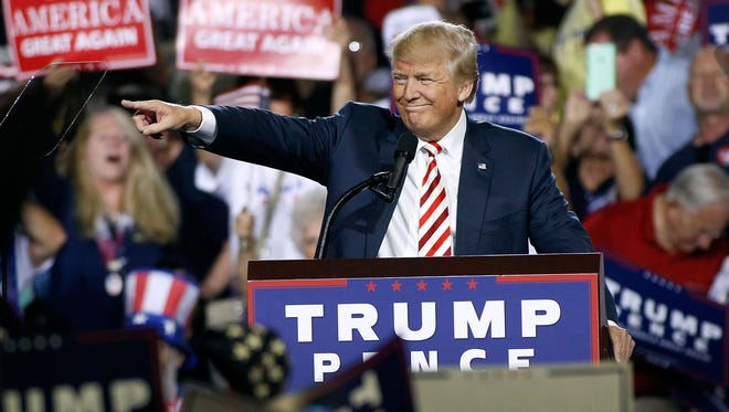 Republican presidential nominee Donald Trump points out to the crowd of supporters as he arrives at a campaign rally Oct. 4  in Prescott Valley, Arizona.