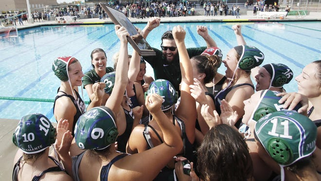 The El Diamante Miners celebrate their win against Redwood in a Central Section Division II championship water polo game in Visalia, Calif., Saturday, Nov. 19, 2016.