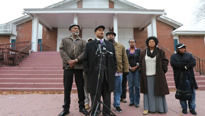 Jerald Muhammad and other local leaders gathered in front of King Solomon Church on Monday morning to preview a Tuesday meeting to discuss tangible solutions to Louisville's current violence problem.