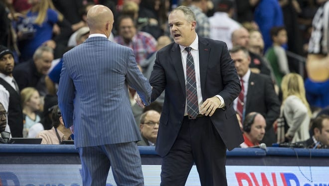 Doug Hood/Staff photographer Seton Hall coach Kevin Willard, left, and Rutgers coach Steve Pikiell share a handshake and some words of mutual admiration after Friday?s game at Prudential Center in Newark. Head coach Kevin Willard and Steve Pikiell shake hands at the end of the game.Rutgers at Seton Hall 2016 Garden State Hardwood Classic takes place at the Prudential Center.Newark, NJFriday, December 23, 2016.@dhoodhood