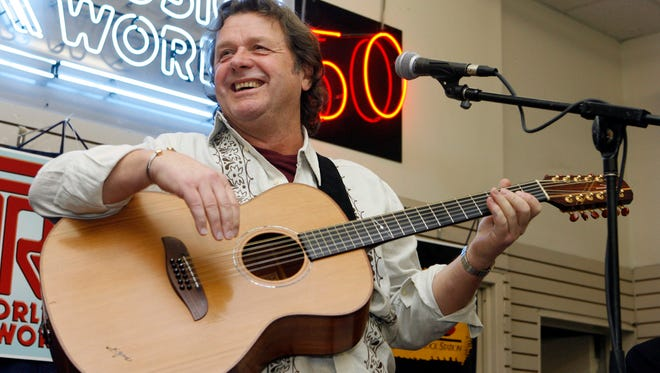 John Wetton performs with Asia at a music store in New York in April 2008.