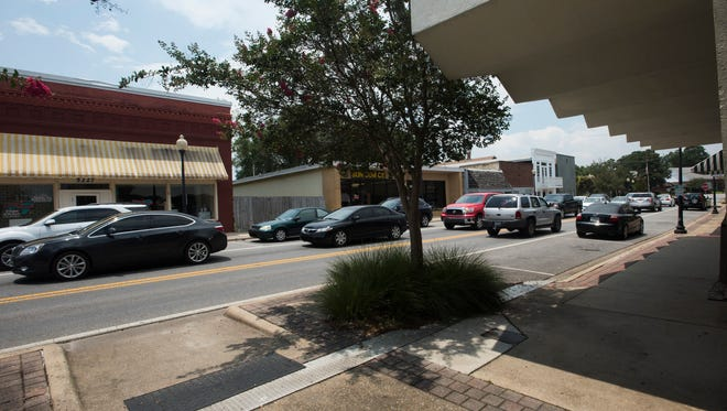 The Milton City Council is considering allowing freestanding bars and taverns in the downtown area. Downtown is pictured on Friday, July 21, 2017.