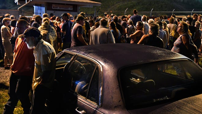 Hundreds waited overnight in a parking lot for the gates to open at 5 a.m. in hopes of getting free medical or dental treatment.