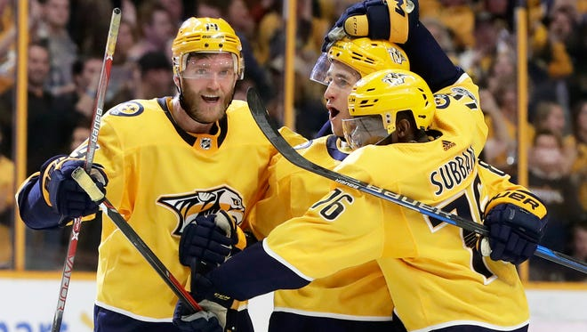 Predators center Kyle Turris, center, has 13 points in 14 games since being traded to Nashville last month.