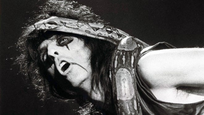 Alice Cooper sings to his pet boa constrictor during a concert at the Veterans Coliseum on 2.1.87.