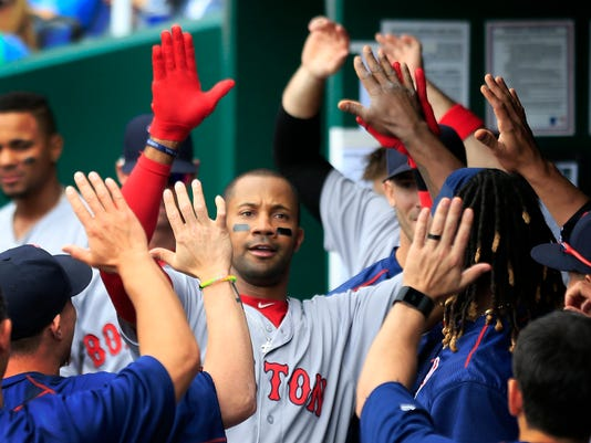 Boston Red Sox's Chris Young celebrates with teammates following his solo home run off Kansas City Royals starting pitcher Ian Kennedy during the fifth inning of a baseball game at Kauffman Stadium in Kansas City, Mo., Wednesday, May 18, 2016. (AP Photo/Orlin Wagner)