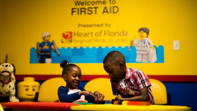 """LEGOLAND Florida Resort in Winter Haven, Fla., recently debuted a wide variety of services and initiatives to assist guests with autism spectrum disorders and their caregivers. They include a no-cost """"Hero Pass"""" that allows groups to bypass the standby line at popular attractions; multiple """"quiet rooms"""" equipped with noise-cancelling headphones, weighted blankets, squishy toys and tables where kids can build with LEGO bricks; """"social stories"""" that offer illustrated, step-by-step walkthroughs of rides and shows to proactively alert guests to periods of darkness, loud noises, bright lights or other elements that often can be frightening or overwhelming. In addition, all newly hired employees (called """"Model Citizens"""") now receive specialized training to more effectively interact with guests on the autism spectrum, as well as their families or caregivers. Last spring, the Central Florida vacation destination partnered with the North and Central Florida chapter of Autism Speaks, the world's leading autism science and advocacy organization, to better serve guests with autism spectrum disorders. Consultations include Dr. Craig Glaser, the resort's medical director, who also serves as medical director of Winter Haven's Urgent Care Cypress facility. (PHOTO: Benjamin Peacock/LEGOLAND Florida Resort)"""