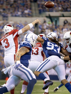 Indianapolis Colts linebacker Jabaal Sheard (93) is called for roughing the passer as he hits Arizona Cardinals quarterback Carson Palmer (3) after he released the ball in the fourth quarter of their game at Lucas Oil Stadium Sunday, Sept, 17, 2017. The Colts lost to the Cardinals 16-13 in overtime.