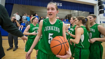 Jenkins guard Whitney Creech reacts after she scored 71 pounts against Paintsville in overtime to become the all-time scorer in Kentucky at 4, 957 Tuesday February 2, 2016 in Paintsville, Ky. Creech started the game 63 points shy of becoming the state's top scorer. (John Flavell/Special to the C-J)