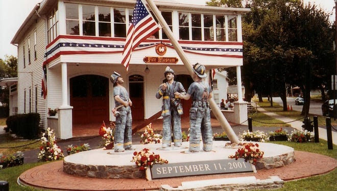 Local artist Richard Kron created the monument to firefighters, which he made from logs from oak trees. A bronze version of it has since been created.