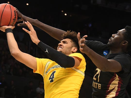 Michigan forward Isaiah Livers shoots against Florida State center Christ Koumadje in the first half of the West regional final of the NCAA tournament at Staples Center on Saturday, March 24, 2018.