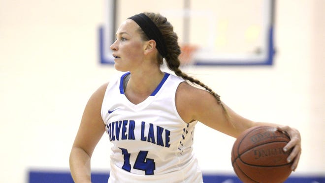 Silver Lake College senior guard Amanda Kudick looks to make a pass while driving up the court during a victory over UW-Fond du Lac on Oct. 27 in Manitowoc.
