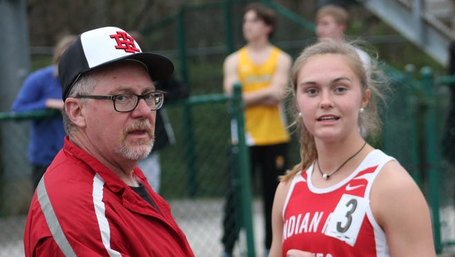 Anna Podojil and Indian Hill assistant Phil Said watch the third leg of the 4x400 relay as the Lady Braves speedster awaits her anchor run.