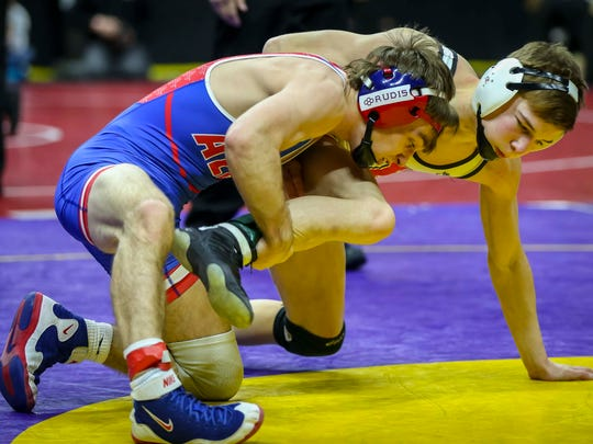 Aden Reeves (Albia) defeated Jack Thomsen (Union, La Porte City) in their Class 2A 120 pounds quarterfinal match Friday, Feb. 16, 2018, at the Iowa state high school wrestling tournament at Wells Fargo Arena in Des Moines, Iowa.