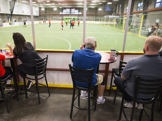 Spectators watch recreation league players compete