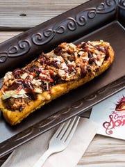 This dish, called Cañoa De Patano Maduro is available at the Empanada Sonata food truck.