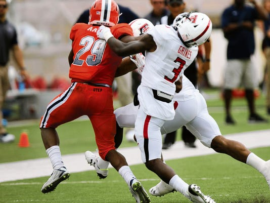 UTEP running back Aaron Jones stiff-arms Texas Tech defensive back J.J. Gaines during their game Saturday in Lubbock. Jones left the game due to an injury and did not return.