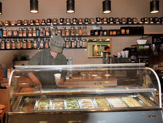 Sacred Grounds owner Will Ponder serves up a scoop of gelato at Sacred Grounds.