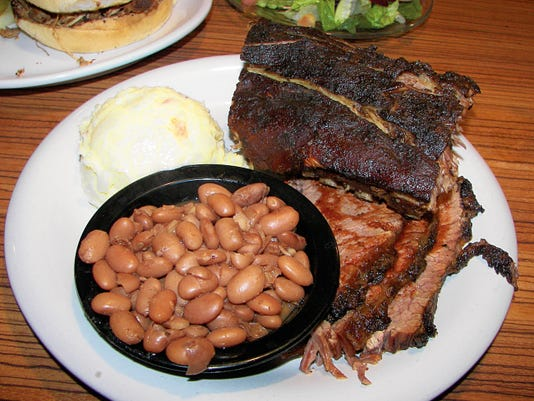The two meat platter (13.99) came with ribs and brisket, plus two sides, beans and potato salad.