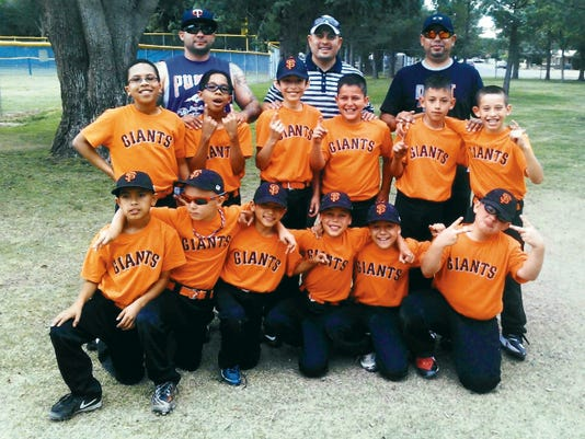 The Deming Optimist Giants captured the regular season team championship in the Minor Division (ages 9-10) of the Deming Little League with a perfect 14-0 record. Coaches are, from left, Jacob Mendoza, Carlos Apodaca and Carlos Jaquez. Players are, standing from left, Ethan Cruz, Zachary Cruz, Aaron Romero, Jacob Hernandez, Cesar Ramirez and Carlos Apodaca. Kneeling from left are Carlos Camunez, Riley Apodaca, Noah Aguiia, Aiden Jaquez, Kaleb Mendoza and Marcus Moreno.