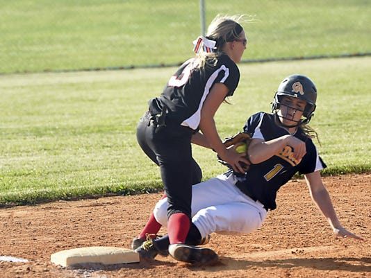 Dover's Meghan Goodman, left, catches Morgan Clopper, of Greencastle, for an out at third base on Tuesday during the District 3 Class AAA playoffs. The Blue Devils won 5-1.