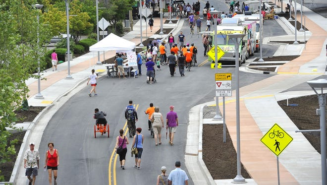 Walkers and bicyclists turn out Saturday for the city's first-ever Open Streets Nashville festival in the Gulch. The event was hosted by Mayor Karl Dean's office in partnership with Walk/Bike Nashville.