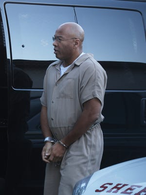 Richard Leon Wilbern, arriving at federal court for an earlier hearing,  is accused of robbing the credit union at Xerox Corp. in Webster on Aug. 12, 2003 and murdering Raymond Batzel, of Lima, Livingston County, who was a customer.