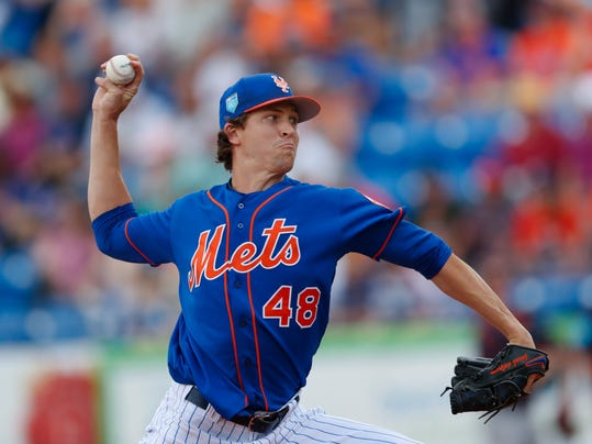 New York Mets starting pitcher Jacob deGrom (48) works in the first inning of a spring training baseball game against the Houston Astros, Sunday, March 11, 2018, in Port St. Lucie, Fla. (AP Photo/John Bazemore)