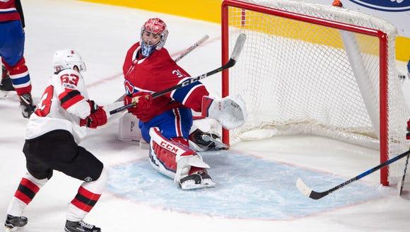 New Jersey Devils left wing Jesper Bratt (63) scores