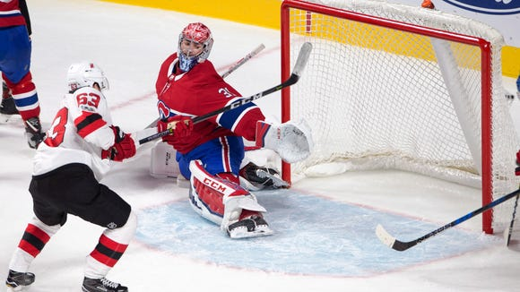 New Jersey Devils left wing Jesper Bratt (63) scores against Montreal Canadiens goalie Carey Price (31) during the third period of a preseason NHL hockey game, Thursday, Sept. 21, 2017 in Montreal. (Ryan Remiorz/The Canadian Press via AP)