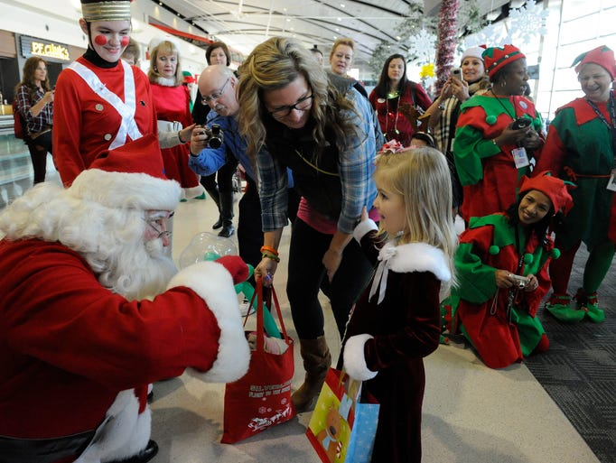 Santa greets  Phoebe Keech and mother Carrie Keech