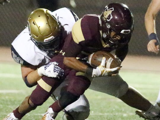Andress wide receiver Diego Lewis, 3, is brought down just shy of the goal line against Coronado Friday at Andress. The play resulted in a 3-point field goal for the Eagles.